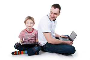 Dad and son with laptop and tablet
